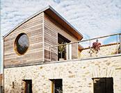 Surélévation bois d'une maison en pierres
